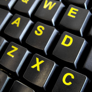 Accuratus Mini Hi Vis keyboard keys in yellow font