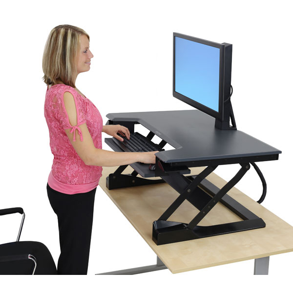Demonstrating Ergotron Workfit-T sit stand desk